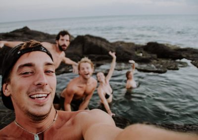 3-boys-and-2-girls-swimming-in-the-sea-pools-in-nimbu-surfhouse-el-transito-leon-nicaragua