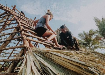 The-beginning-girl-and-boy-building-the-roof-of-a-cabin-in-nimbu