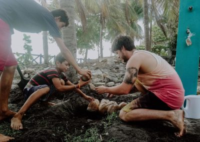 The-beginning-nimbu---three-boys-planting-coconuts-near-the-sea.