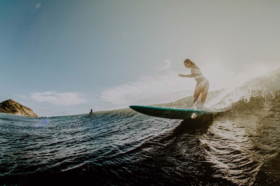 beginner girl surfing on a wave in el transito Nicaragua